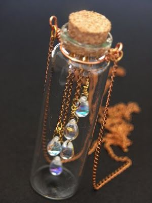 Rain in a bottle...I have a little cork bottle like this...and really love this idea! Think I'll have JoJo wire wrap it for me....