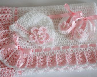 Handmade, lovely crochet blanket, is an ideal covering for your baby.  In Pink, decorated with satin ribbon bows in white.  Dimensions approx 34 x 34  Baby booties size 0-3m  100% acrylic yarn  If you would like a different color or size, please contact us.  Feel free to buy!  Thank you for your interest in my items.
