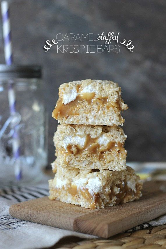 Caramel Stuffed Krispie Bars.  A fun twist on krispie treats with a simple, delicious layer of caramel stuff in the center!