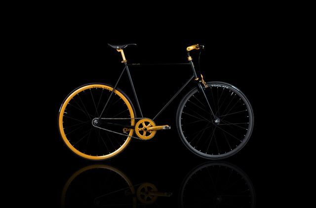 Fixed in Black & Gold from Italian watch-maker TOO LATE's pop bicycle debut.