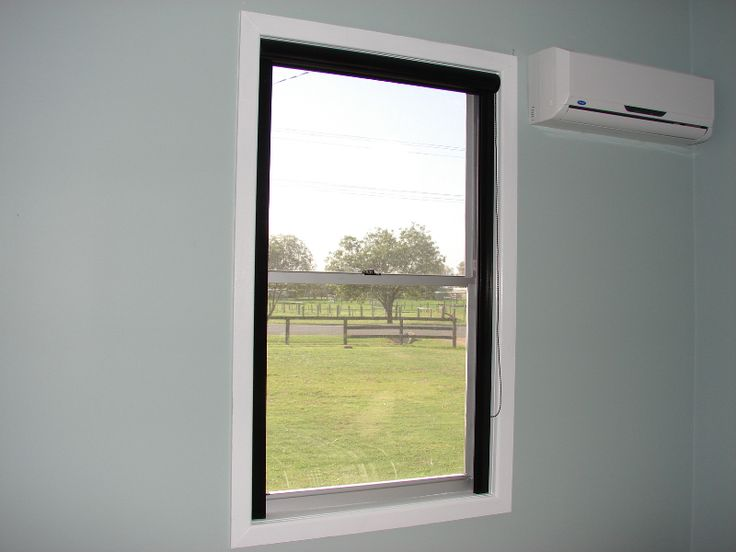 Motorized blackout shades with side channels