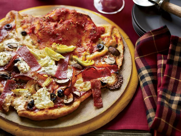 Pizza Vesuvio with the Works   At Rustic, Francis Ford Coppola's new restaurant in Geyserville, Coppola's half-pizza, half-calzone is named for Italy's Mount Vesuvius. More Pizz...