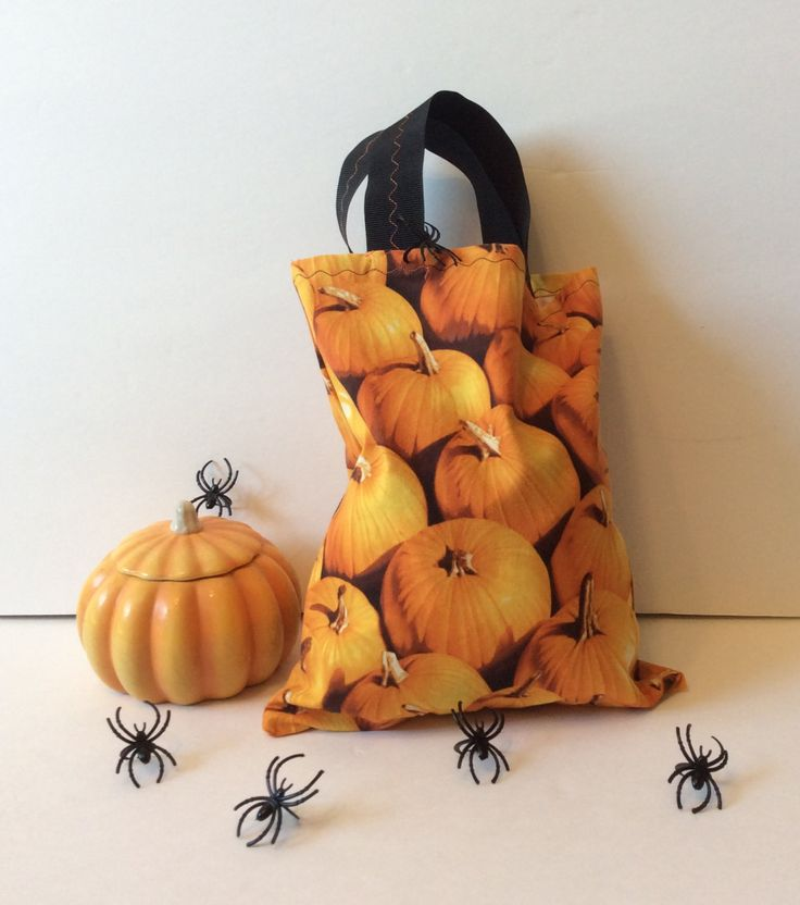 Halloween Trick-or-Treat Tote Bag.  Treat bags for your kids for Trick-or-Treating.  These will last for years and will be a fun tradition to pull out each Halloween.  Cute Pumpkin Print Fabric with Black 1.5 inch wide Heavy Duty Grossgrain Ribbon Handles.  Bag and Handles have decorative top stitc