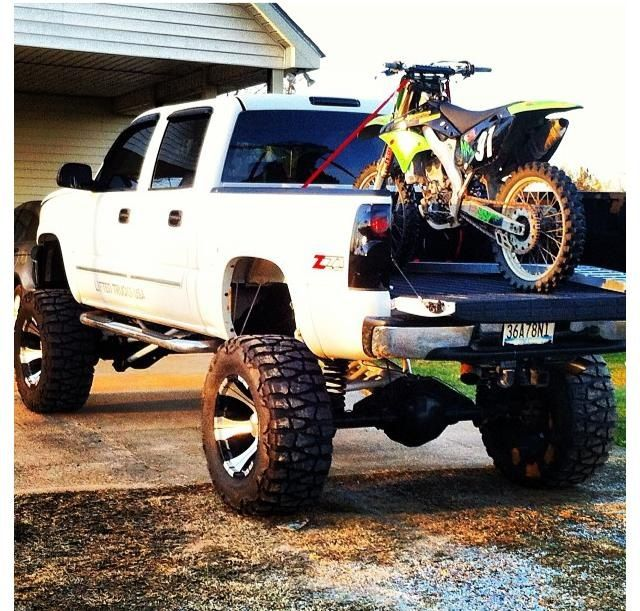 the only thing better than a jacked up truck is if it 39 s got a dirtbike in the back love it. Black Bedroom Furniture Sets. Home Design Ideas