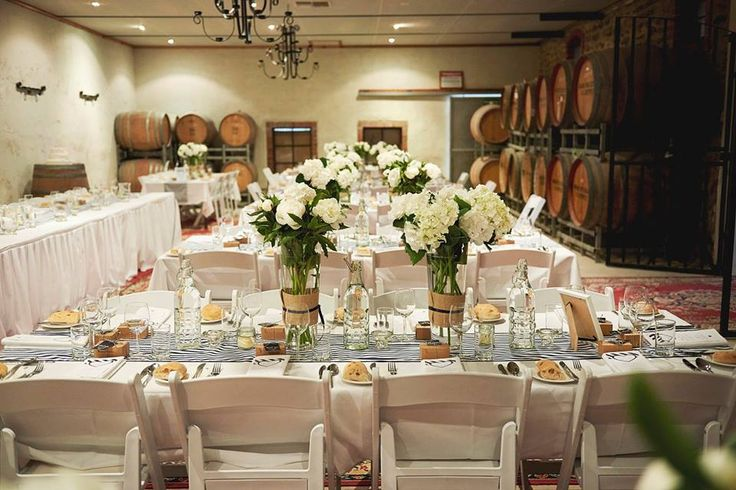 Another lovely Wine Store reception setting. Photo by Melanie Nelson Photography, Flowers by Jasmine Leaney.