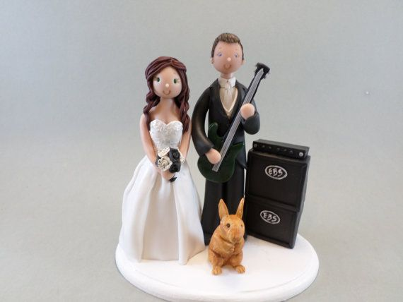 This listing is for a bride and groom wedding cake topper, which starts at $135 and made to fit your description (attire, hair and eye color, bouquet etc.) All images are just an example of my previous work and prices may vary according to your needs. ADDITIONAL COSTS : • name and date plaque - $3 • cats / dogs - $20 • third figure - $50 • children - $20-$25 (depending on size and attire) • hats / helmets - $5 • vespa /bike - $35 • music instruments - $15 • drums - $35 • piano ...