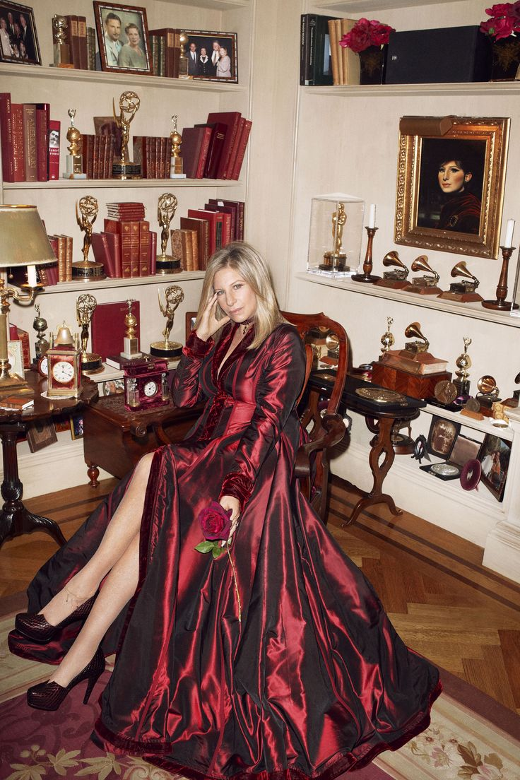 Awards season: Streisand and some of her accolades in the den. Gown, $4,295, Les Habitudes. 310-273-2883. Shoes, Streisand's own. Hair: Chris McMillan for Chris McMillan Salon; makeup: Pati Dubroff; manicure: Lorri Keefer-Smith; production: Joy Asbury Pro   - HarpersBAZAAR.com