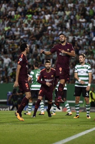 Sergio Busquets and Luis Suarez of FC Barcelona celebrate after score the first goal during the UEFA Champions League group D match between Sporting CP and FC Barcelona at Estadio Jose Alvalade on September 27, 2017 in Lisbon, Portugal.