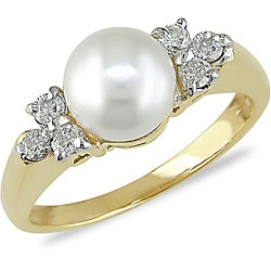 @Overstock.com - Click here for Ring Sizing ChartWhite pearl ring is flanked by diamond trios14k yellow gold jewelry  http://www.overstock.com/Jewelry-Watches/Miadora-14k-Gold-Cultured-Pearl-and-1-5ct-TDW-Diamond-Ring-7-7.5-mm/4032130/product.html?CID=214117 $335.99