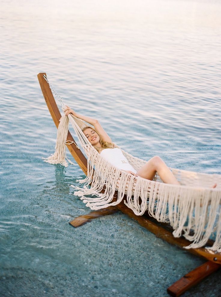 Want to Elope by the Sea? This is Where You Should Do It. Photo by Thecablook Fotolab - Concept, planning & design by I Wish Chic Events - Videography by Nikos Fragoulis - HMUA by Marylou Tzivelekis - Model Michaela Pospisilova - Macrame hammock by Boho choco
