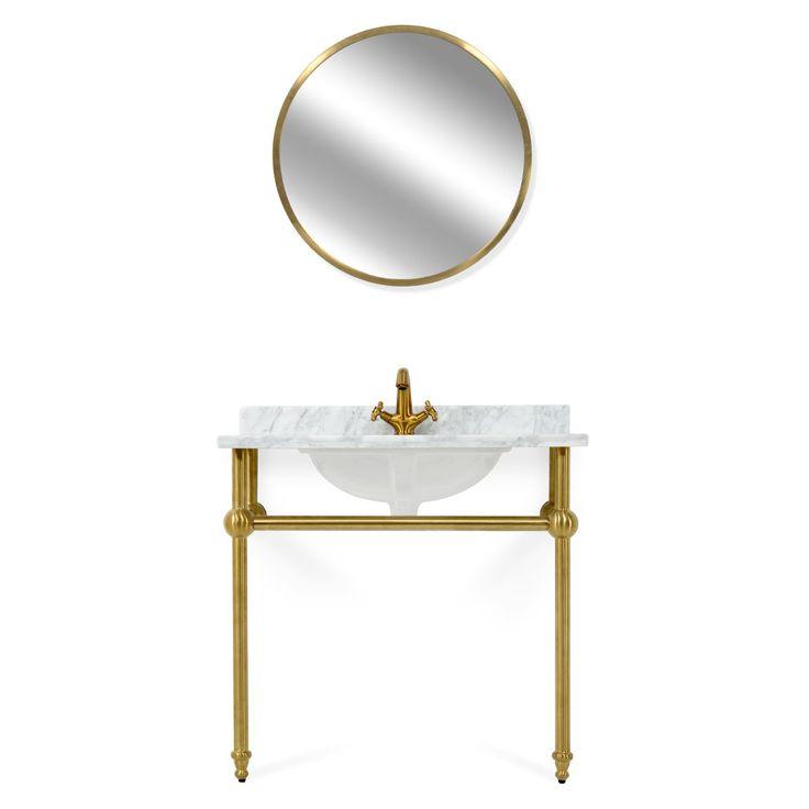 Grație elegantului set Hotel, ce include un corp lavoar și oglindă, puteți conferi băii voastre un aspect încântător. Corpul pentru lavoar și rama oglinzii sunt realizate din inox cu finisaj alamă, iar lavoarul este realizat din ceramică, cu blat de marmură. #mobexpert #mobilier #baie