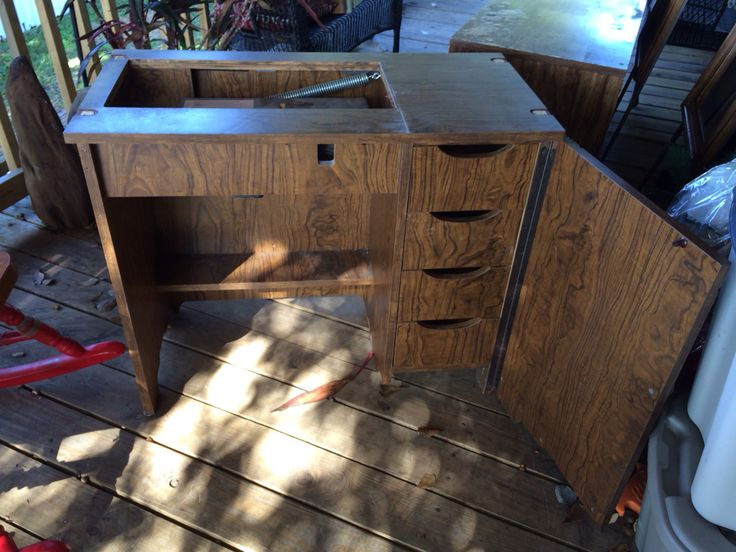 Before- vintage sewing machine cabinet open view