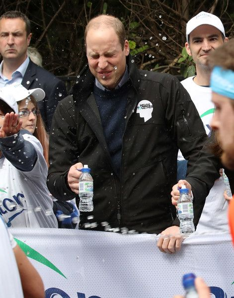 A runner squirts water towards Prince William, Duke of Cambridge as he hands out water to runners during the 2017 Virgin Money London Marathon on April 23, 2017 in London, England. The Duke and Duchess of Cambridge and Prince Harry, are spearheading Heads Together, in partnership with eight leading mental health charities, that are tackling stigma, raising awareness, and providing vital help for people with mental health problems.