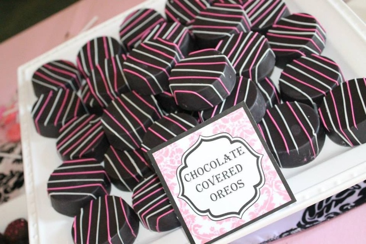 Damask pink and black baby shower dessert buffet.  Chocolate covered  Oreos