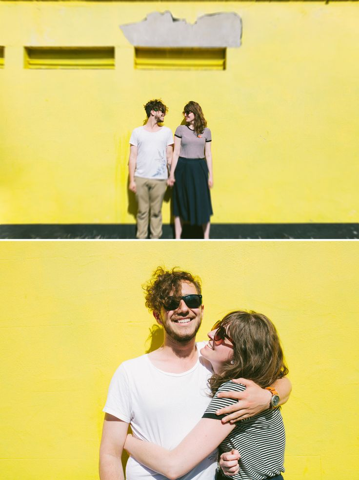 Cute couples photography in front of a coloured wall