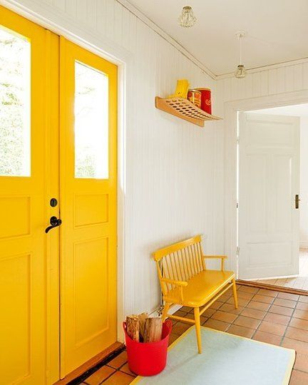 Bright yellow, crisp white and red accents entrance. A bench for removing and hanging shoes!