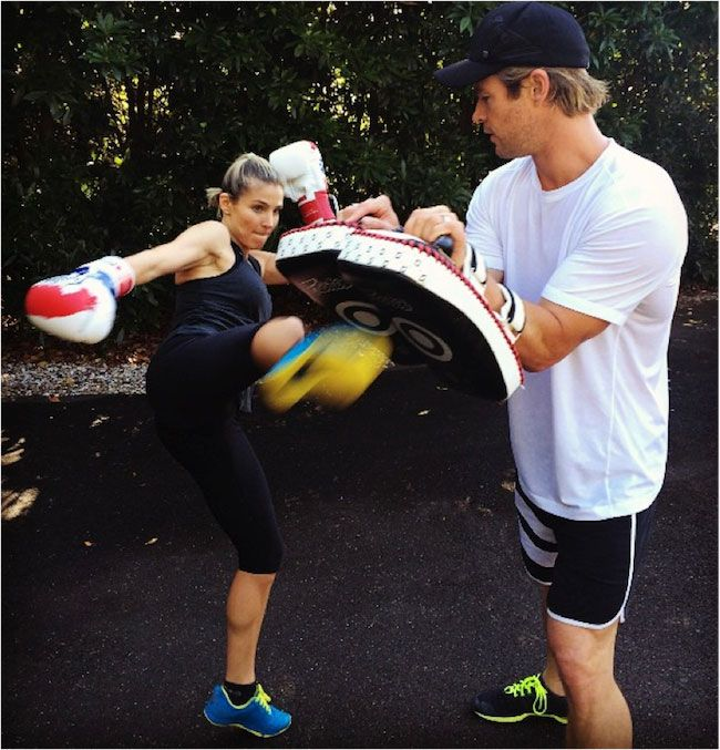 Elsa Pataky and Chris Hemsworth exercising...