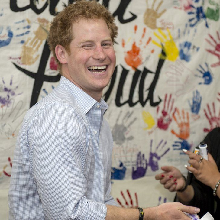 Pin for Later: Watch Prince Harry Put a Purple-Paint Handprint on a Photographer's Head