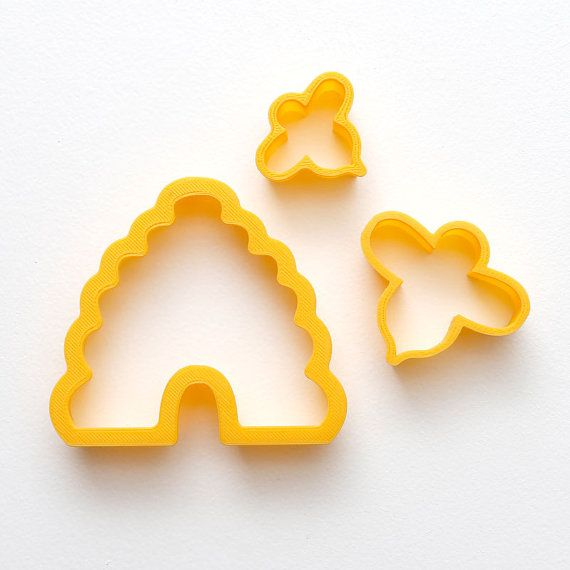 Custom 3D-printed beehive shaped cookie cutter with separate honey bees for cutouts, impressions, or single bee cookies. Comes in a nested set