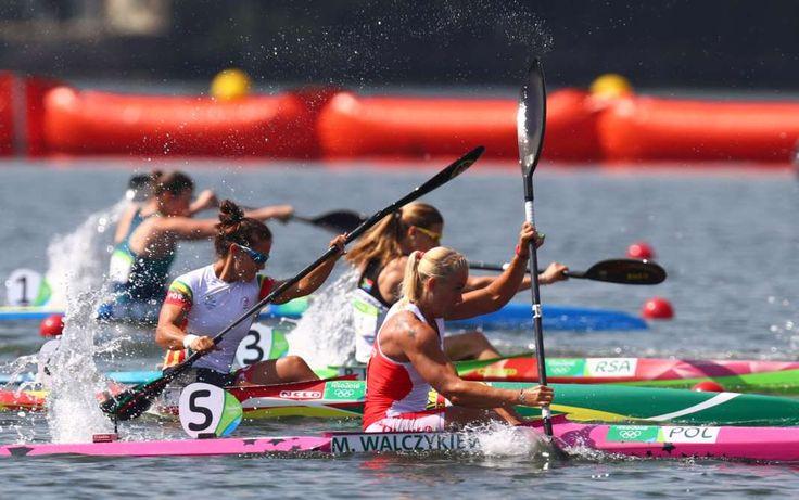 Competitors paddle during women's kayak 200-meter single semifinal during canoe…