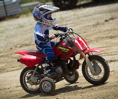 Motocross with training wheels, one way to start them young.