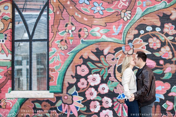 Engagement photos in front of mural, Liberty Village. Toronto couples photography #sweetheartempirephotography