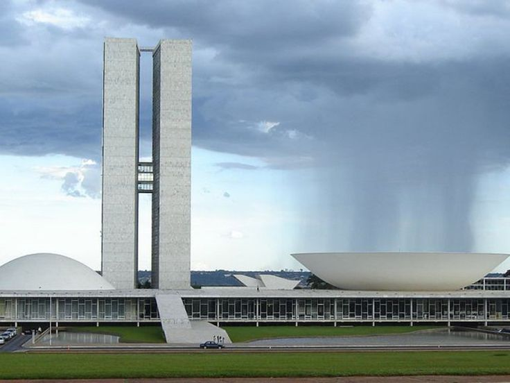 The National Congress of Brazil is the seat of Brazil's government and is arguably Niemeyer's most famous construction. It was completed in 1958. The building is defined by clean lines and curved structures; it has two semi-spheres which are divided by two vertical towers.