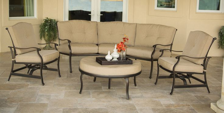 Hanover 4-Piece Traditions Outdoor Deep Cushion Lounge Set, Natural Oat/Antique Bronze. Includes 2 deep-seating rocker chairs, 1 crescent-shaped sofa and 1 round over-sized ottoman. Each chair rocks seamlessly while the legs remain grounded. Rust-resistant, all-weather cast aluminum frames. Plush, foam cushions wrapped with treated olefin fabric to resist moisture, stains and UV harm. Some assembly required-hardware provided.