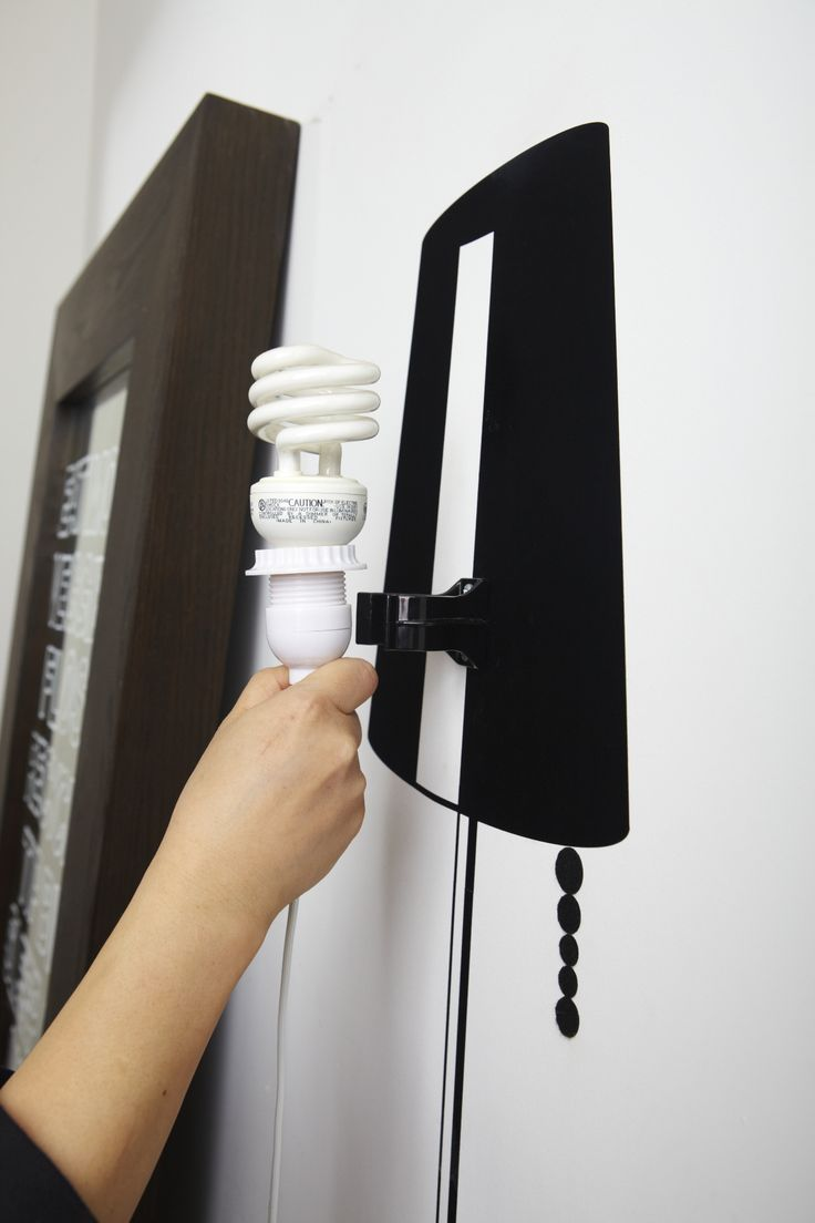 """A simple wall decal and a lamp cord are the perfect recipe for a fabulous """"faux"""" floor lamp that doesn't leave a large footprint and that you can take with you."""