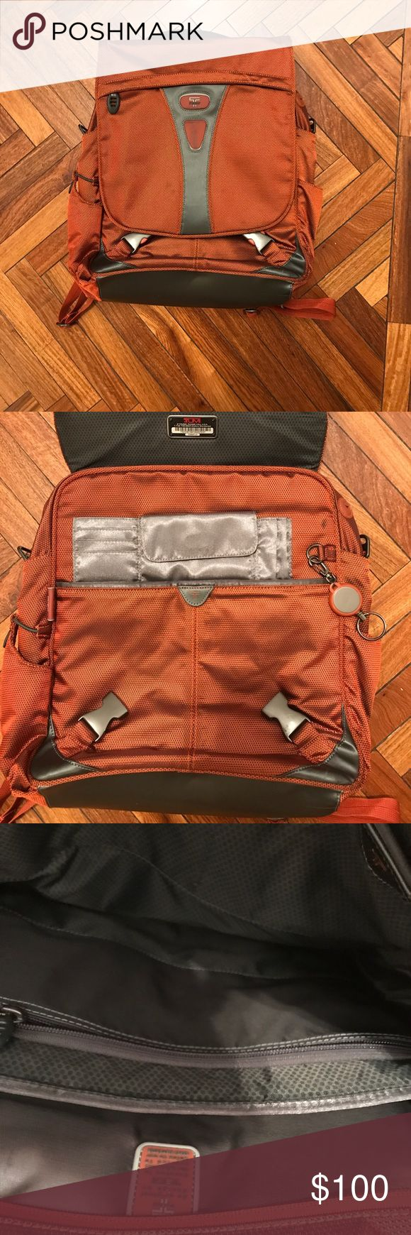 Tumi Tech dark orange laptop  back pack Tumi Tech dark orange computer back pack. Flap has a zip pocket. 2 compartments inside one side has a zipper pocket as well as 2 additional pockets. When u open the flap you have a Velcro pocket for change as well as slots for credit cards. Adjustable straps.  *** missing shoulder strap*** otherwise in very good condition. Tumi Bags Laptop Bags