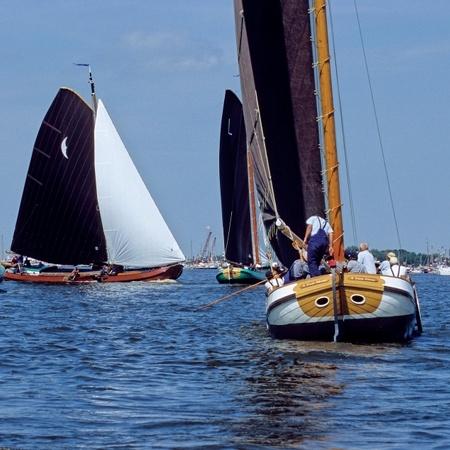 The Netherlands, Province of Fryslãn ( = Friesland), The Netherlands - Tjeukemeer. Skûtsjesilen ( = sailing with skûtsjes).