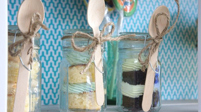 cupcakes layered in a jar and sold with a spoon. It's looks rustic, i like it. Perfect for a bake sale or market stall