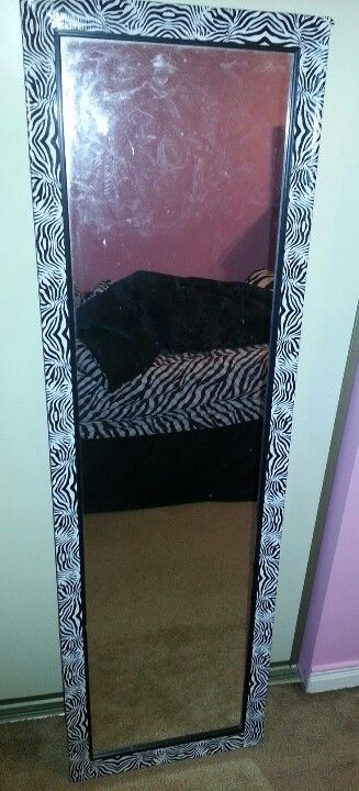 DIY Zebra print mirror. $6.00 printed ducktape from Michael's. Soooo incredibly easy!! You can do this with anything! :)