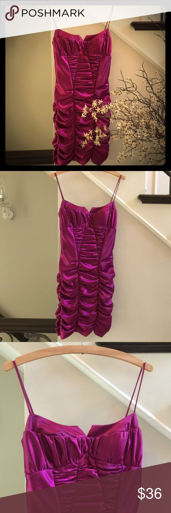 Masquerade Hot Purple Mini Dress HOT HOT HOT! Is the compliment you will get with this definite sexy dress! A Beauty and the Beast inspired design with scrunched fabric that flatters your figure! A peek-a-boo cut out around chest and fitted waist! Spaghetti straps with a zipper in back for an easy fit! Perfect for any party!!! (Some snagging as seen in photo above.) Masquerade Dresses Mini
