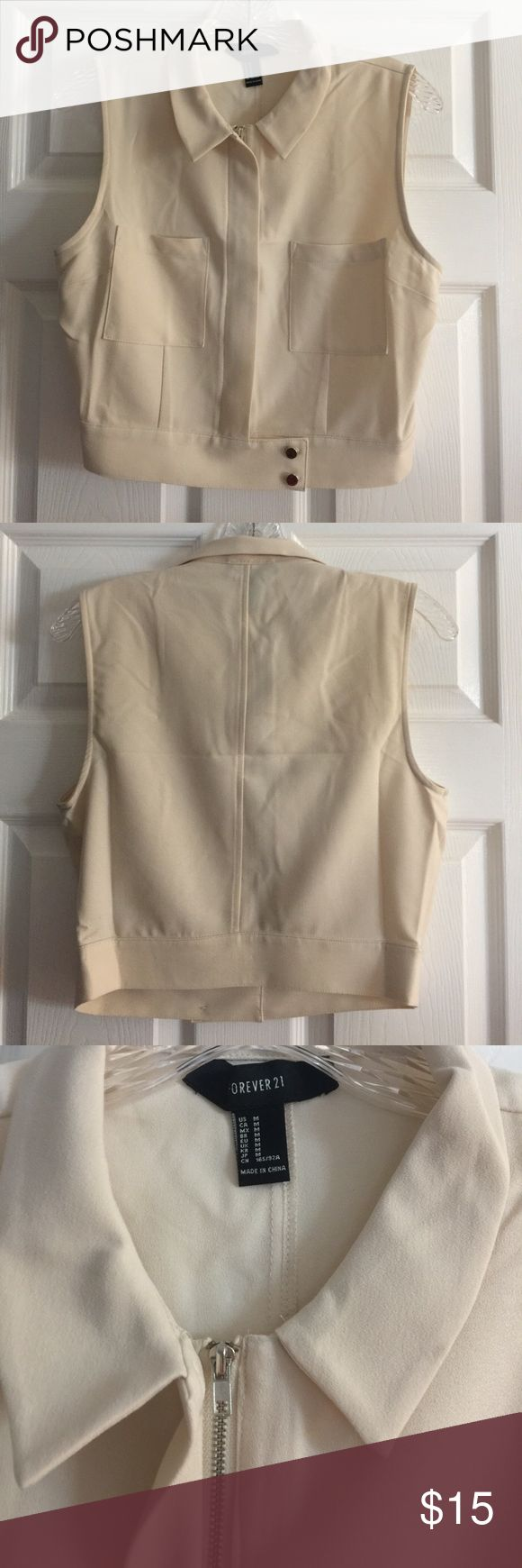 F21 Cream Zip-Up Vest Forever21 Cream zip up vest. Double breasted pockets, double buttons on bottom. NWOT. Forever 21 Jackets & Coats Vests