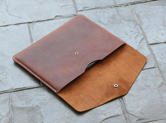 I pinned this because of the simple but effective design for a iPad... This would be about a day in construction time...  https://www.etsy.com/shop/kncustomleather