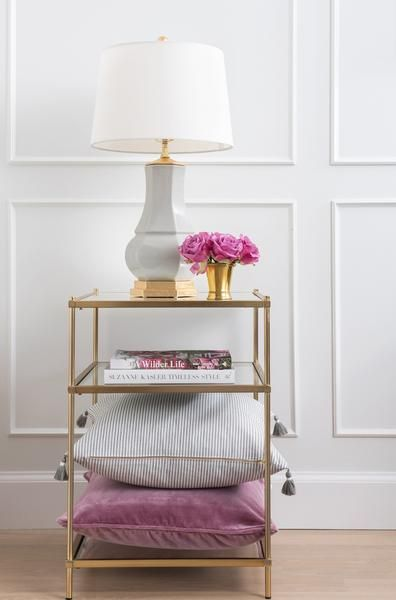 Light up your space with lustrous dove grey porcelain adorned with luxe gold leaf hardware. This neutral and versatile piece adds a luxurious, chic touch in any room. | Caitlin Wilson