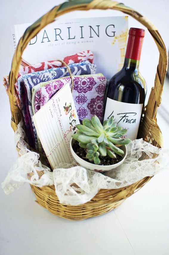How pretty is this? Wine, kitchen linens, recipe cards, a succulent & a magazine. You could add a candle or wine bottle opener as extra items. My favorite is the succulent! Although the linens are a close second, I'm a sucker for Anthropologie's style! { Source }