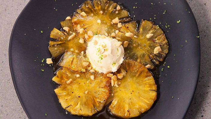 Glazed pineapple with salted peanuts and coconut ice-cream