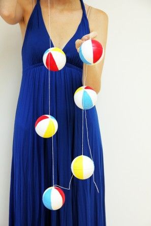 DIY Mini Beach Ball Garland - So Perfect for a Pool Party! Link for the How-to:    http://www.studiodiy.com/2012/07/31/diy-beach-ball-garland/