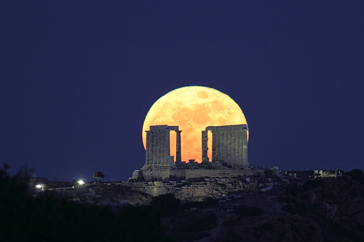 Moonrise and the temple of Poseidon at Sounio, Greece