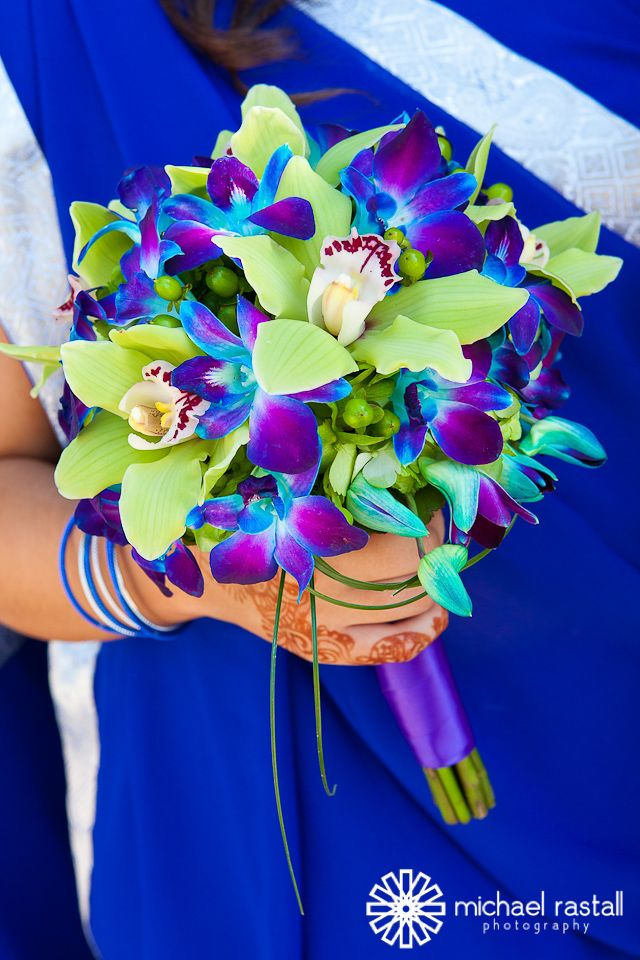 Elegant bride bouquet with cymbidium orchids and blue orchids