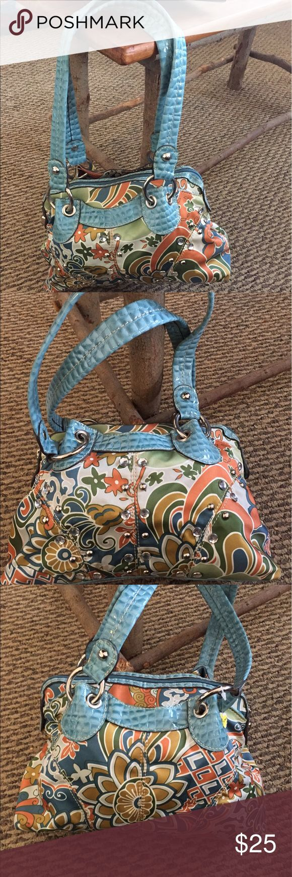 Kathy Van Zeeland shoulder bag. Beautiful colors. Kathy Van Zeeland shoulder bag. Beautiful colors of turquoise, gold, green & tangerine. Two outside pockets. Lining is patent leather turquoise. Inside zippered pocket and card slots. Kathy Van Zeeland Bags Shoulder Bags