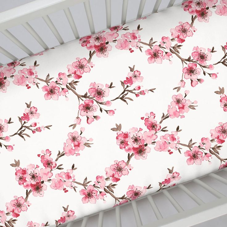 "Crib Fitted Sheet in and Pink Cherry Blossom by Carousel Designs.  Our fitted crib sheets feature deep pockets and have elastic all the way around the edges to hug mattresses securely. Fits standard crib mattresses, measuring approximately 28"" x 52""."