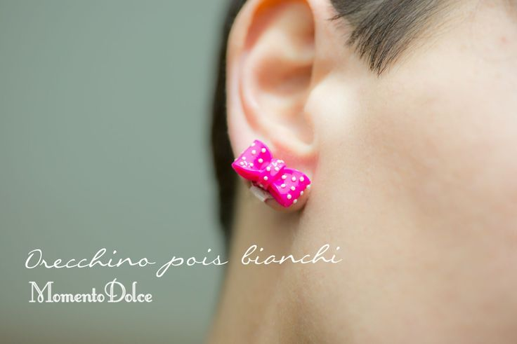 pink earrings with white pois