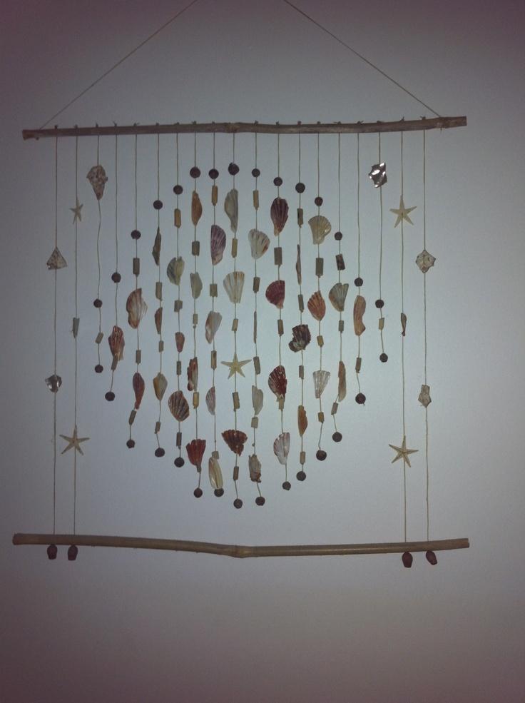 Circular shaped shell wall hanging ! Made by Pip Wardlaw on the Gold Coast .