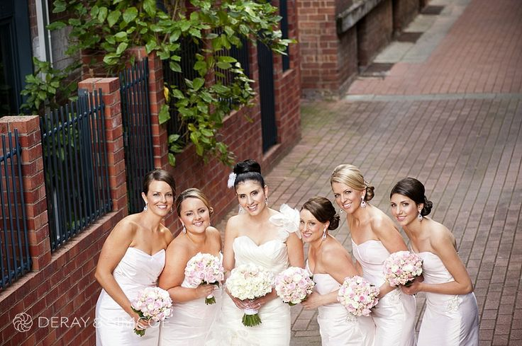The girls. Bridesmaids wearing pretty soft pink dresses with pink and white bouquets