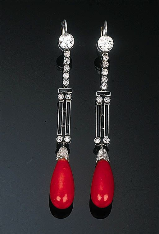 A Pair of Art Deco Coral, Diamond and Enamel Ear Pendants   Each set with a coral drop to a diamond-set cap and black enamel double bar all suspended from an articulated diamond line and diamond collet, circa 1940, 7.0 cm long