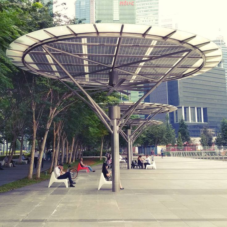 .  Huge Solar Powered Public Fan .  Shelters the Sun & Rain . .  #shelter #solarpower #public #space #fan #huge #sun #shelter #shade #seat #tech #tropics #singapore #hightech #energy #cool #sit #architecture #design #need #power #metal #construction #tree #useful #block #big #tropical #street #art