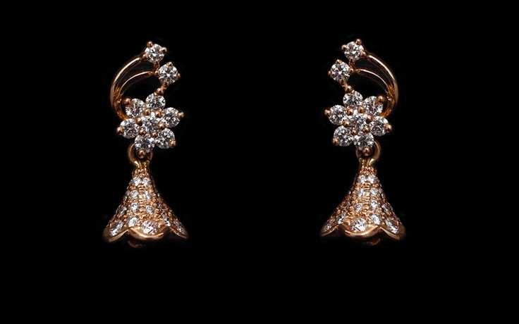 Create a harmony with your child's wardrobe with this pair of bell-shaped diamond jhumikis. The price is $2000